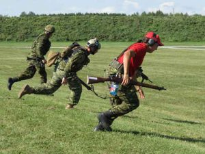 Master Corporal Donny Sutherland, right, runs from one shooting position to another in a competition.