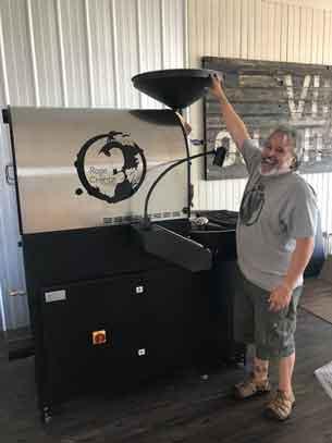 Jamie Nichol with the coffee roaster at Rose N Crantz