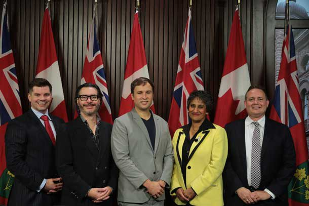 """Left to right: Mike Garnett (Bay Street Labs), Paul Vallée (Pythian), Floyd Marinescu (InfoQ & QCon), Audrey Mascarenhas (Questor) and Chris Ford (Capco) of """"CEOs for Basic Income"""" at Queen's Park today. (Photo credit: Moses Leal at FEATHERSTONE photo & imaging"""