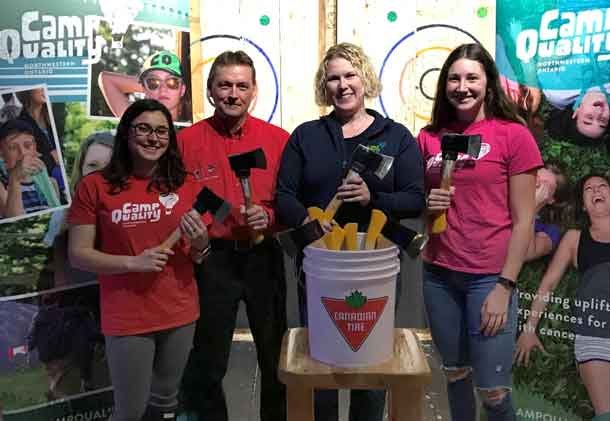 Camp Quality Northwestern Ontario excitedly launched the Axe Cancer fundraising event presented by Canadian Tire Thunder Centre to take place November 18. From left, Camp Quality's Sam Stovel, Canadian Tire Thunder Centre's Harry Fediuk and Camp Quality's Ashleigh Quarrell and Jacqueline Hanley.