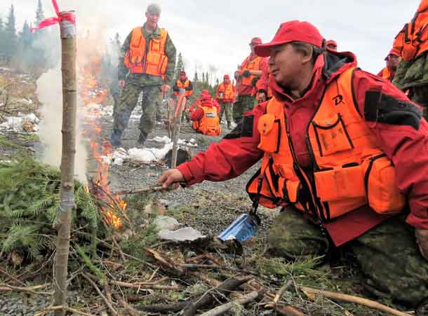 Master Corporal Yvonne Sutherland of Kashechewan practices lighting a fire quickly to warm a search victim.