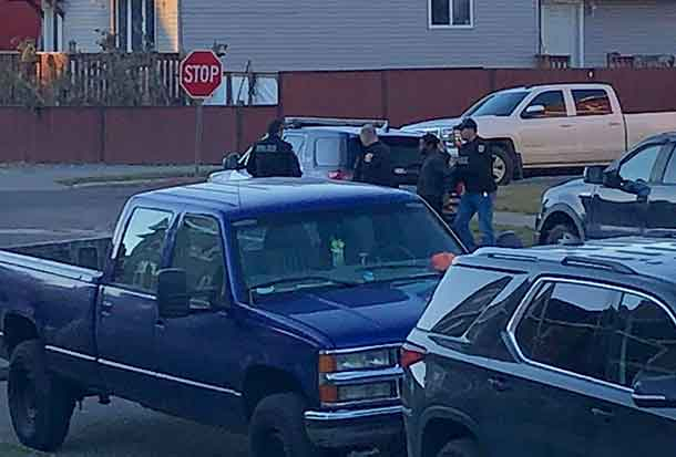 Police with suspect in custody on Dease Street