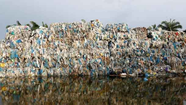 Plastic waste piled outside an illegal recycling factory in Jenjarom, Kuala Langat, Malaysia October 14, 2018. Picture taken October 14, 2018. REUTERS/Lai Seng Sin
