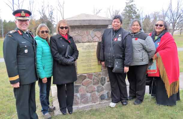 Brigadier-General Jocelyn Paul, left, with granddaughters of Sergeant Francis Pegahamagabow at a cairn honouring him as Canada's most highly decorated Indigenous soldier. They are, from left, Theresa McInnes, Karen Pegahmagabow, Eva Jane Poytress, Robin Pegahmagabow, and Laura Pegahmagabow. Photo by Sgt Peter Moon