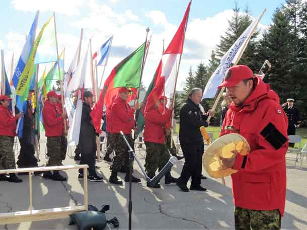Ranger Howard Jacob of Webequie drums as Grand Entry enters the circle. Photo by Sgt Peter Moon