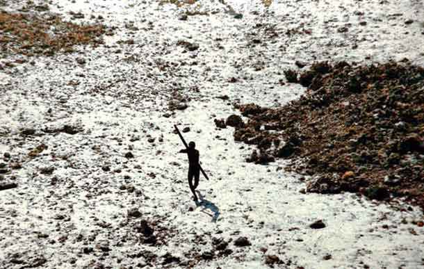 This member of the Sentinelese tribe was photographed firing arrows at a helicopter which was sent to check up on the tribe in the wake of the 2004 tsunami . The Sentinelese people have long made it clear that outsiders are not welcome and they wish to be left alone. © Indian Coastguard/Survival