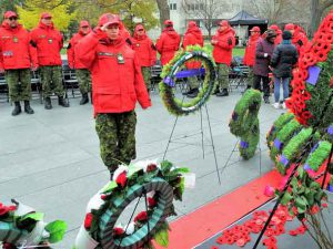 """A contingent of Canadian Rangers from 12 First Nations from Northern Ontario participated in a prominent Remembrance Day ceremony in Toronto on November 11. Wearing their distinctive red jackets and combat pants, they attracted a lot of curious attention from many in the large crowd at the Ontario Veterans Memorial in front of the main entrance to Queen's Park. The memorial, a 30-metre-long granite wall, has scenes on it of the Canadian military's role in peace and war since 1867.When the Rangers explained their role as part-time army reservists in the province's Far North and their involvement in search and rescue missions, evacuations for floods and forest fires, and other emergencies many people shook their hands and thanked them for their military service to their communities and Canada. After the Remembrance ceremony the Rangers were invited to a reception in Ontario Lieutenant-Governor Elizabeth Dowdeswell's vice regal suit in the Legislature, where they met both her and Ontario Premier Doug Ford. """"I found the ceremony very interesting,"""" said Corporal Joe Lazarus of Kashechewan. """"I never expected to meet the Lieutenant-Governor and the Premier."""" """"It was an experience to see all the army, navy, air force, cadets, and all the people at the wall,"""" said Sergeant Charlie Linklater of Sandy Lake. """"This has been a very interesting experience."""" It was the first time Rangers have been to a Remembrance Day ceremony in Toronto. The ceremony this year observed the centennial anniversary of the end of the First World War and was the culmination of a 12-day training visit to the south. In addition to the ceremony at Queen's Park they attended a ceremony on November 5 in a Burlington cemetery where school children places poppies and Canadian flags on the graves of veterans. They also visited a school in Burlington where they were peppered with questions about their lives in the Far North. On November 9 they took part in a Remembrance Day ceremony at Rama First Nation where t"""