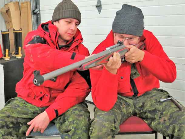 Ranger Austin Baxter and Master Corporal Donny Sutherland get a feel for one of the new Canadian Ranger rifles delivered to Constance Lake.