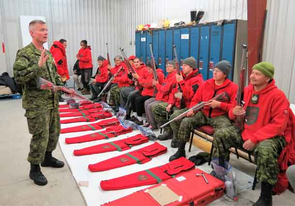 Warrant Officer Chris Thomson, an army instructor, trains Canadian Rangers in Constance Lake in the use of the new Ranger rifle.