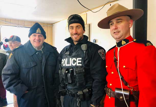 RCMP S/Sgt Roy with NAPS Constable Roy and Tavis Clemens of the RCMP