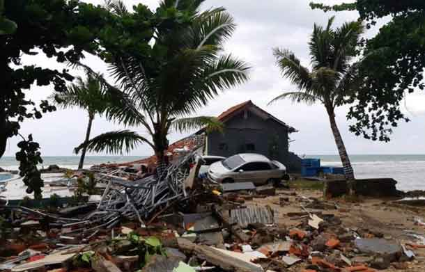 A car is seen among ruins after a tsunami hit Carita beach in Pandeglang, Banten province, Indonesia, December 23, 2018. REUTERS/Adi Kurniawan