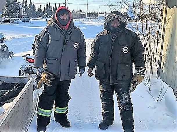Master Corporal Mike Koosachin, left, with Marcel Metatawabin in a file photo after his rescue in 2016.