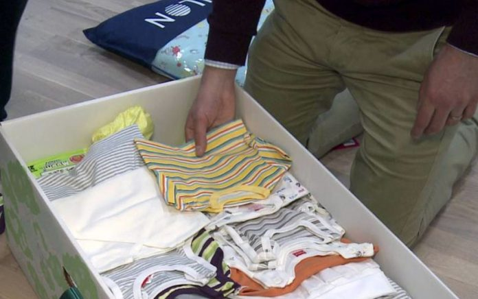 The contents of the Finnish baby box are seen in this still image taken from video in Espoo April 29, 2015. REUTERS/Attila Cser
