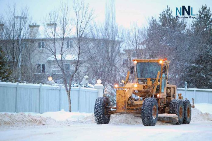 Grader clearing snow on street. Image: depositphotos.com