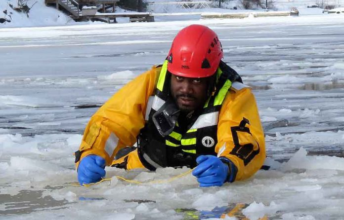 Sergeant Eric Scott wears an immersion suit to combat the cold water - Image Sgt Peter Moon