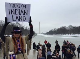A participant holds a placard during the Indigenous Peoples March at the Lincoln Memorial in Washington, D.C., on Jan. 18, 2019. Thomson Reuters Foundation/Carey L. Biron