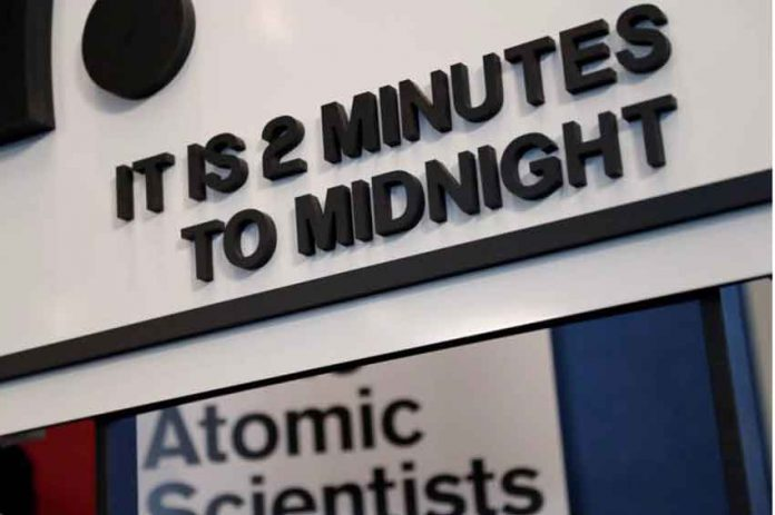 "The updated time designation is visible underneath the 'Doomsday Clock' during a news conference"" in Washington, U.S., January 25, 2018. REUTERS/Leah Millis"