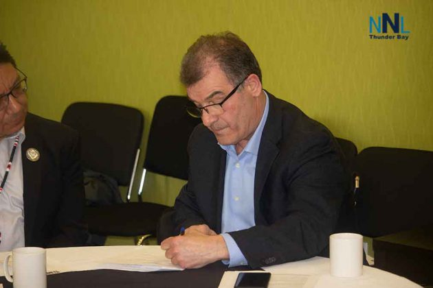 Kenora MP Bob Nault signs the agreement in Thunder Bay