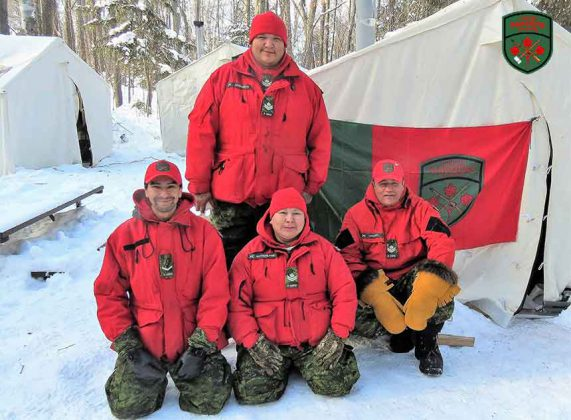 Four Canadian Rangers who passed on survival kills were, kneeling from left, Ranger Richard Yellowhead, Master Corporals Yvonne Sutherland and Joe Lazarus, and, standing, Master Corporal Bradley Anderson. Photo by Sgt Peter Moon
