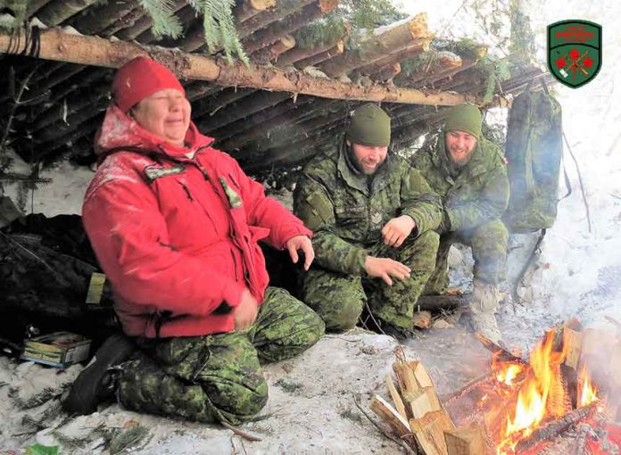 Sharing a laugh in an emergency shelter are, from left, Master Corporal Yvonne Sutherland, Sergeant Chris Brad, and Sapper Clayton Miller. Photo Sgt. Peter Moon