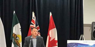 Minister Greg Rickford at announcement on East West Transmission line