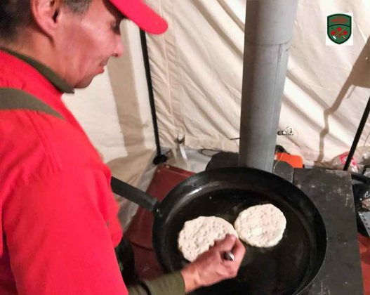 Master Corporal Floyd Fiddler makes traditional bannock in preference to army rations. Image Credit: Master Corporal Jason Hunter, Canadian Rangers