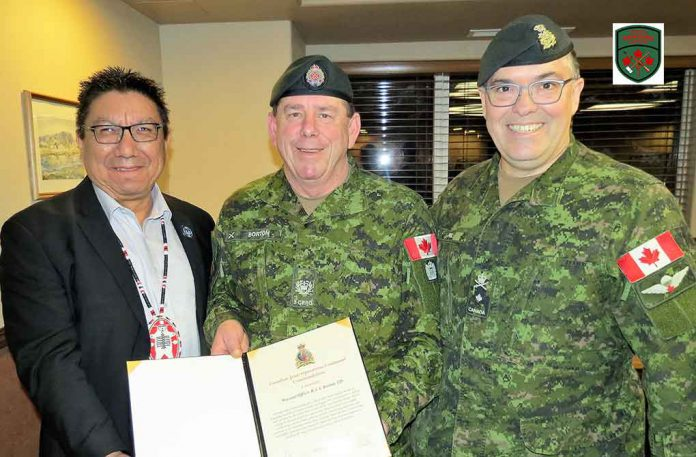 Master Warrant Officer Barry Borton, centre, receives his commendation from Grand Chief Alvin Fiddler and Brigadier-General Jocelyn Paul.