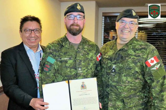 Major Charles Ohlke, centre, receives his commendation from Grand Chief Alvin Fiddler, left, and Brigadier-General Jocelyn Paul.