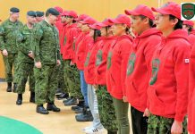 Brigadier-General Jocelyn Paul inspects newly graduated Canadian Rangers in Pikangikum.
