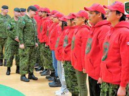 Brigadier-General Jocelyn Paul inspects newly graduated Canadian Rangers in Pikangikum.