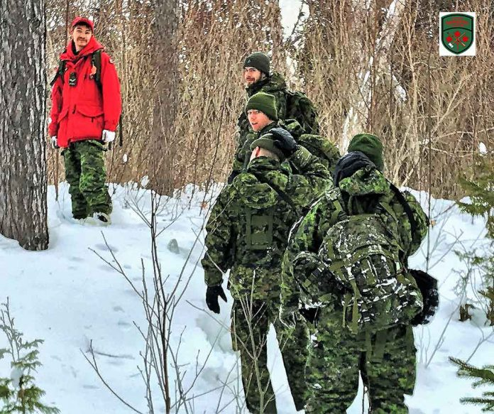 Ranger Quinton Anishinabie leads southern soldiers on snowshoes during the exercise. Image Credit Master Corporal Jason Hunter, Canadian Rangers