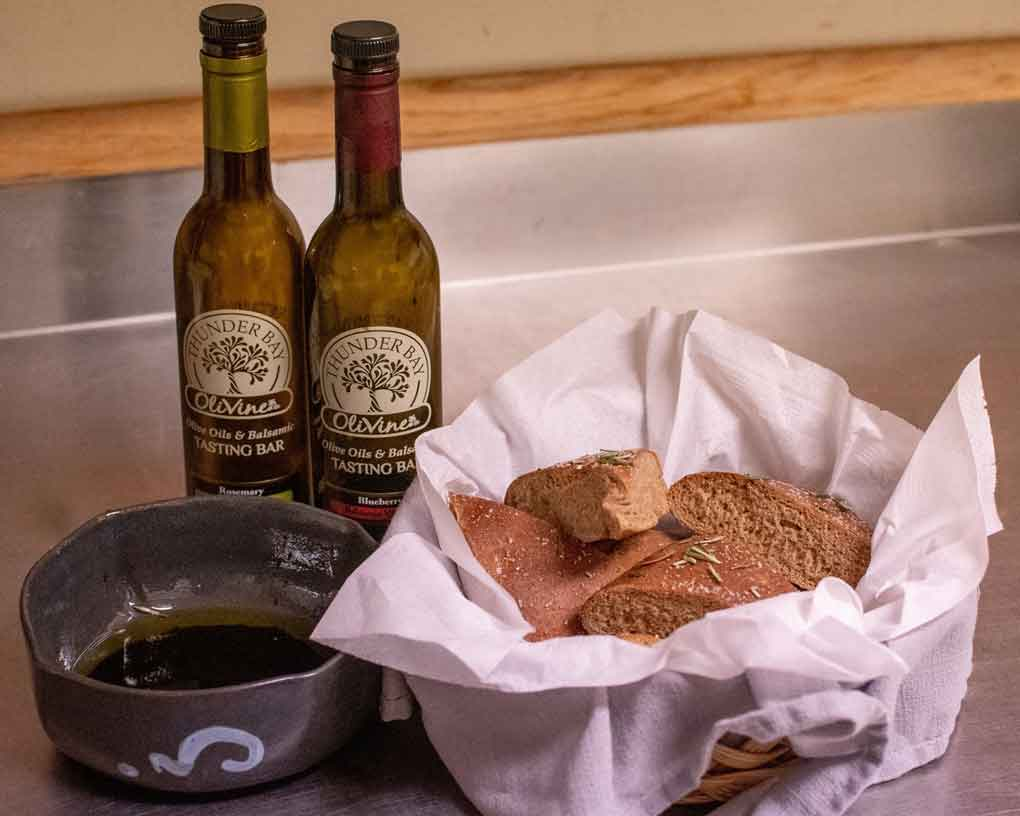 Photo Credit - Claudia Ochnicki Photography: Homemade fresh baked focaccia cut in wedges and served with balsamic and olive oil from A Fine Fit Catering and Consulting