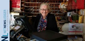 91-year-old Eileen O'Krafka, Canada's oldest Postmaster, sitting at the desk of the store she has been a fixture in since 1969 in Rostock Ontario. A broad range of historic advertising from Eileen, some of it dating back to the original owner of her building, is now being offered for sale through Miller & Miller Auctions Ltd., of nearby New Hamburg.