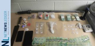 RCMP Manitoba image of weapons, drugs and money seized in The Pas