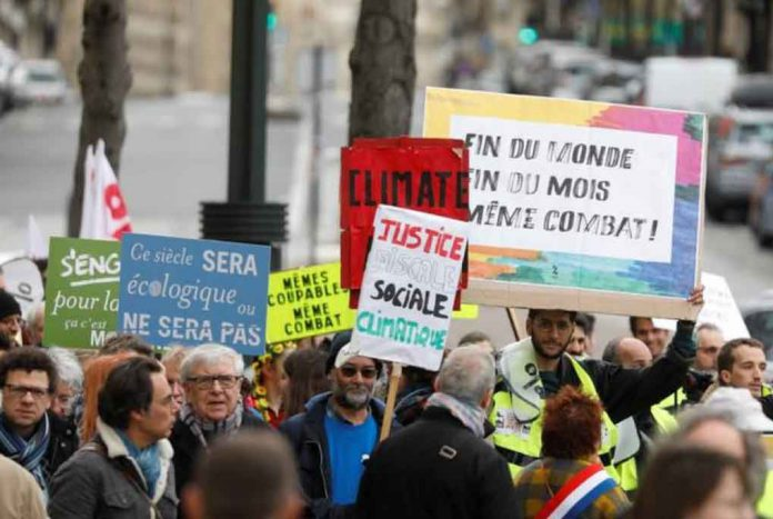 People attend a demonstration asking for urgent measures to combat climate change, in Paris, France, March 16, 2019. REUTERS/Charles Platiau