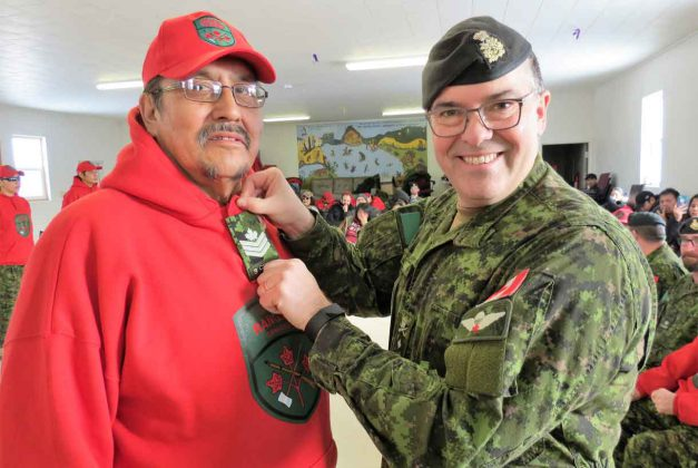 Sergeant Charles Wesley receives his rank insignia from Brigadier-General Jocelyn Paul, commander of the Canadian Army's 4th Canadian Division, at the opening of the new Cat Lake Canadian Ranger patrol in February.