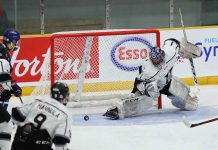 Kings goalie Jordan Smith is unable to get the right pad over in time as Calgary's Carter Benoit (18) gets the Buffaloes on the scoreboard first at 4:14 of the first period.