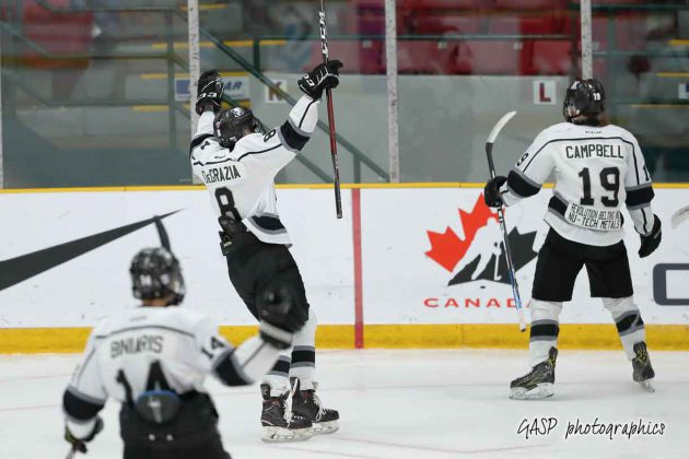 Kings Nicholas DeGrazia heads over to congratulate Nikolas Campbell on his 1st period goal.