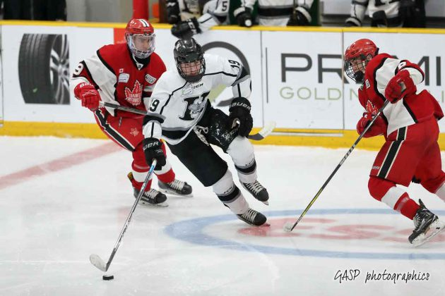 The Kings Nikolas Campbell splits through Toronto's Noah DeSantis and Joshua Sinanan in the neutral zone in 2nd period action.
