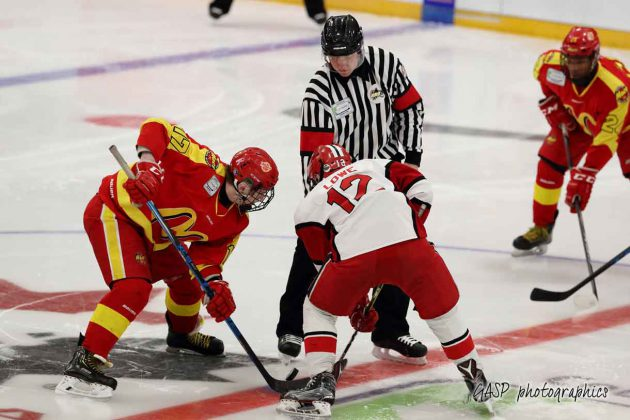 Cameron Brown (left) of Halifax, facing off against Toronto's Nolan Lowe faces off against Cameron Brown