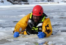 Sergeant Eric Scott hauls himself out of broken ice during ice rescue training.