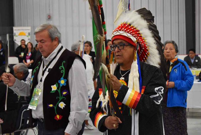 Couchiching First Nation Chief Brian Perrault and Ogichidaa Francis Kavanaugh, Grand Chief of Grand Council Treaty #3 at Grand Entry this morning at the Treaty #3 Spring Assembly being held in Couchiching First Nation.