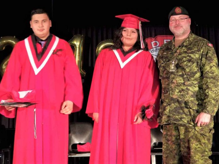 Tyler Tait, left, and Christyn Koostachin, centre, two of five Junior Canadian Rangers who have graduated from Dennis Franklin Cromarty High School in Thunder Bay, with Captain John McNeil, right, the Canadian Army officer commanding Junior Rangers in Northern Ontario - Photo Credit 2nd Lt. Jack Teskey