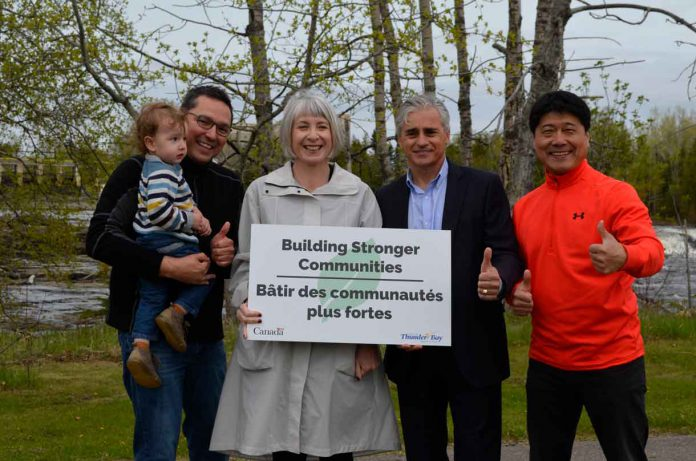 Don Rusnak, Patty Hajdu, Mayor of Thunder Bay, and Peng You at announcement