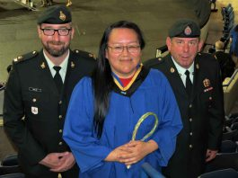 Master Corporal Jocelyne Sutherland of Fort Albany,centre, with Major Charles Ohlke, left, and Master Warrant Officer Barry Borton, after receiving her bachelor of social work degree.