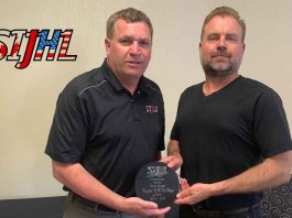 SIJHL commissioner Bryan Graham (left) presents the league's 2nd Annual Community Service Award to Dryden GM Ice Dogs president Michael Sveinson (right).