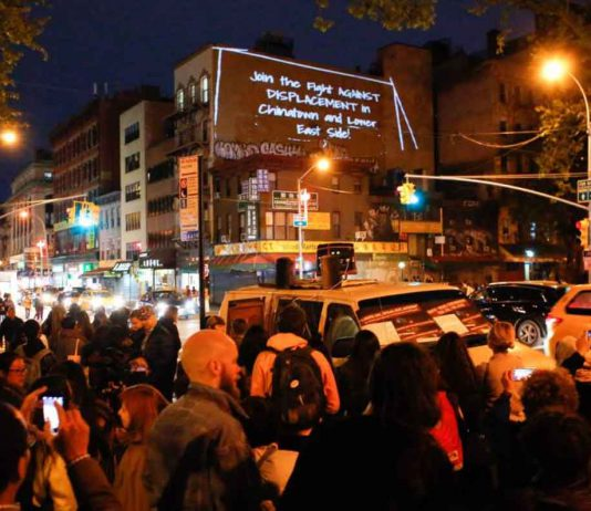 Activists and participants take part in a tenants rights action in Chinatown, New York City, on May 12, 2017. Handout photo courtesy of the Illuminator