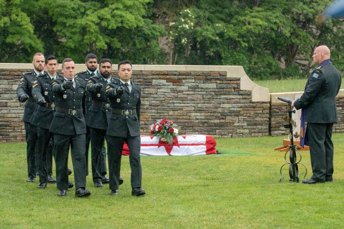 On June 12, 2019 Captain Sye VanMaanen, Padre, leads the burial party from The British Columbia Regiment during the burial ceremony of a First World War fallen soldier, Private George Alfred Newburn at the Commonwealth War Graves Commission's Loos British Cemetery outside Loos-en-Gohelle, France. Photo: MCpl PJ Letourneau, Canadian Forces Combat Camera
