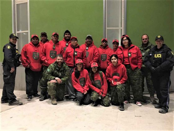 Some of the Canadian Rangers and Ontario Provincial Police officers assisting the evacuation of Pikangikum.