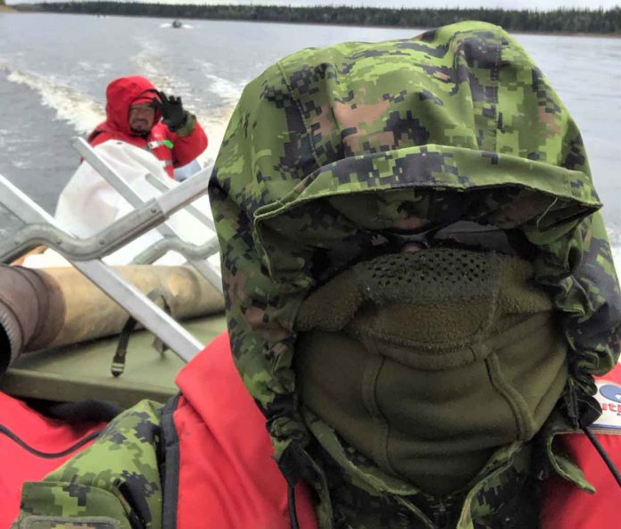 Sergeant Thomas Scott of Fort Albany, left, and Warrant Officer Carl Wolfe bundle up against the cold during the river patrol.
